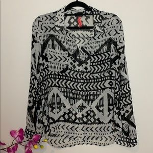 Eight sixty black and white sheer Aztec blouse.